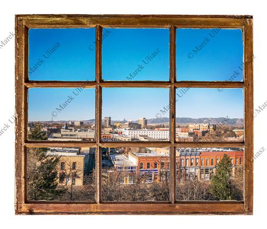 cityscape view through vintage window