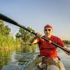 paddling racing sea kayak on lake