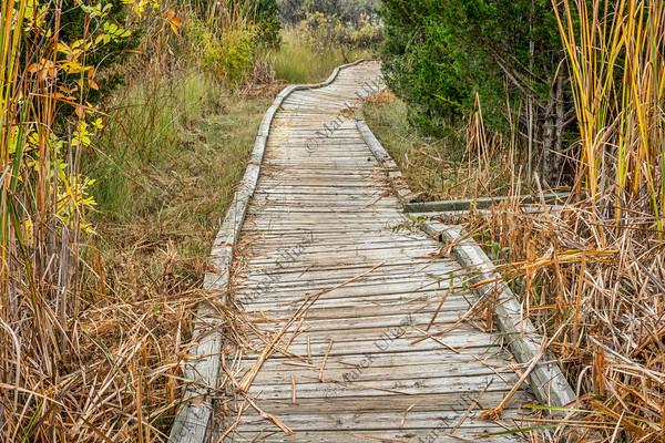 old twisted wooden boardwalk