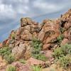 sandstone rock formation under stormy sky
