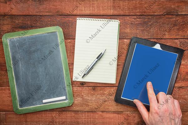 blackboard, notepad and digital tablet