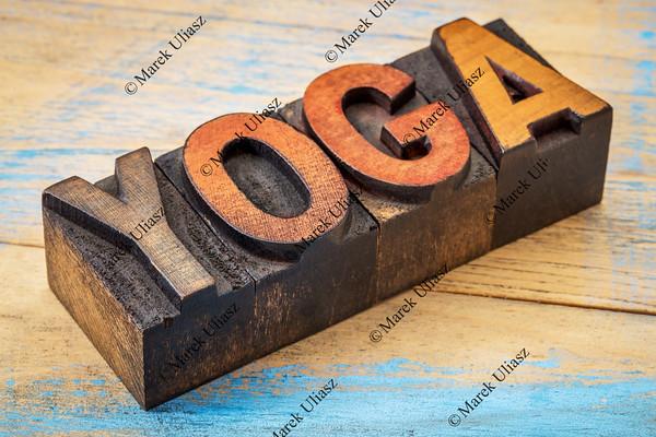 yoga word in vintage wood type
