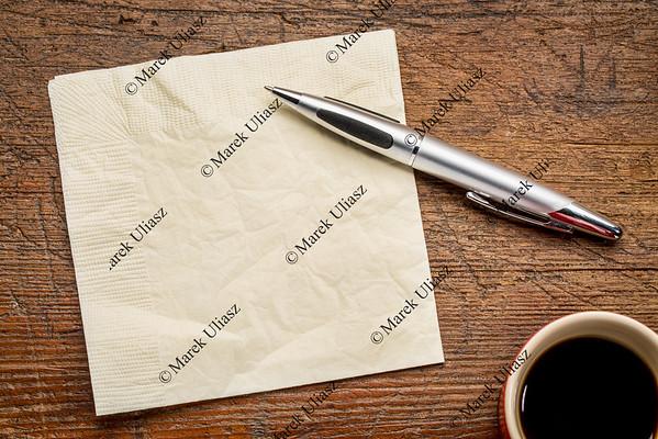 napkin, pen and coffee
