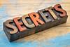 secrets word in wood type