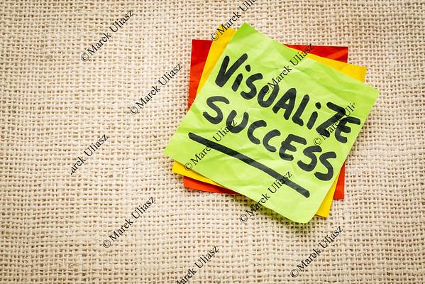 visualize success advice  on sticky note