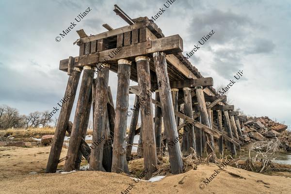 destroyed railroad timber trestle