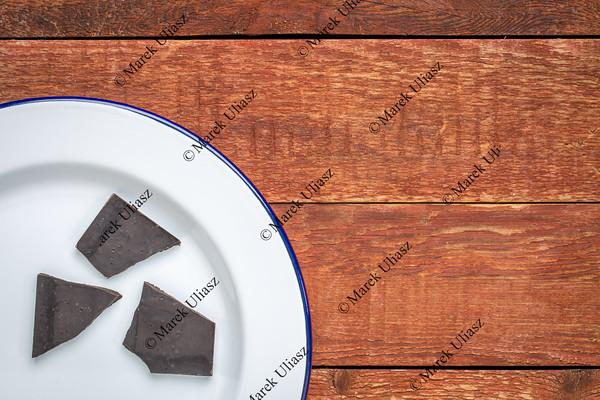 dark chocolate on  a white plate