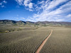 ranch road and Medicine Bow Mountains