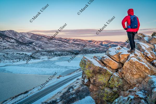 dawn over frozen mountain lake