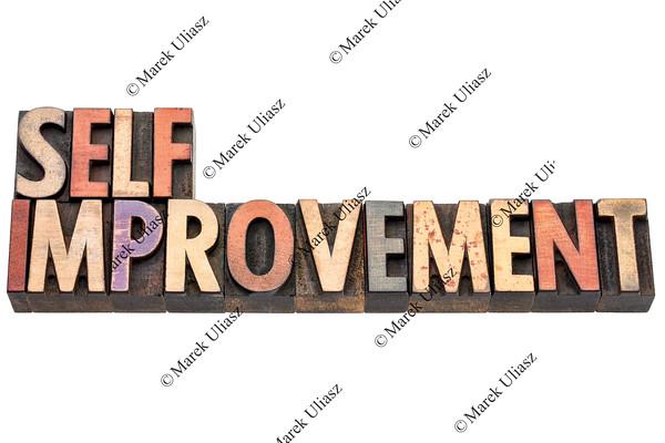 self improvement words in wood type
