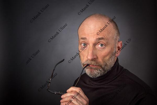 eleder man with reading glasses
