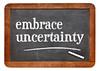 embrace uncertainty blackboard sign