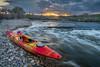whitewater kayak at sunset