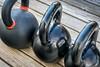heavy iron kettlebels on a deck