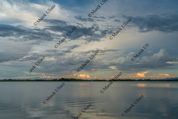 stormy evening sky over  lake