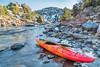 whitewater kayak on river shore