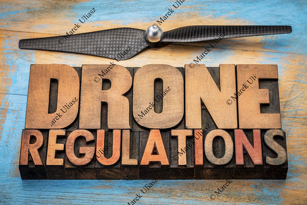 drone regulations word abstract invintage letterpress  wood type with a drone propeller