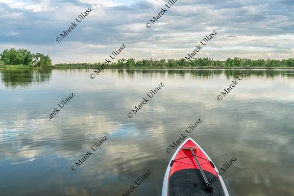 stand up paddleboard on lake