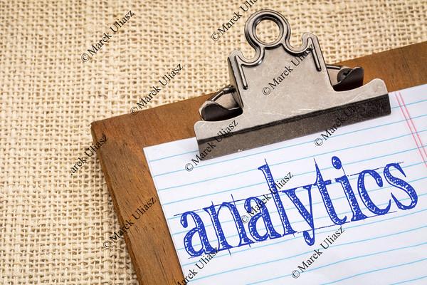 analytics word on clipboard