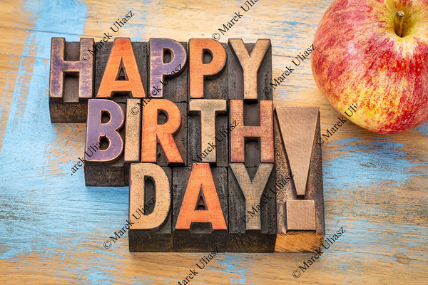 Happy Birthday in wood type with apple