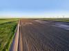 Plowed field and windmill farm