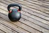 iron kettlebell on wood deck