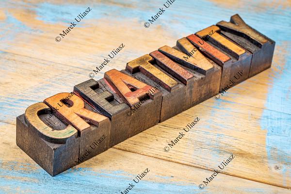 creativity word in wood type