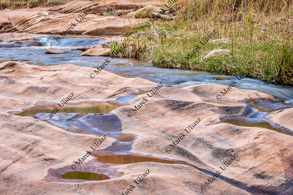 stream flowing over sandstone