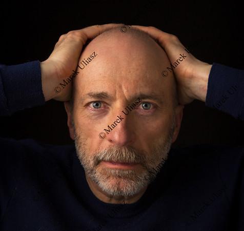 senior bald bearded man headshot