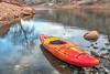 whitewater kayak on rocky shore