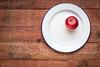 red apple on metal enamel plate