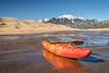 whitewater kayak in shallow water