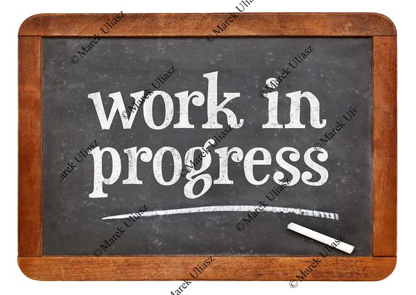 work in progress blackboard sign