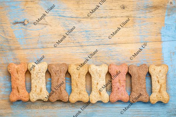 row of milk bones on wood