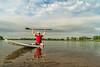 senior paddler on stand up paddleboard