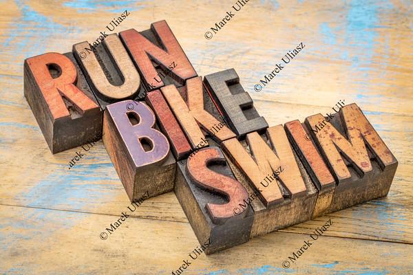 run, bike, swim in wood type