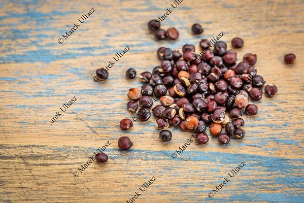 black quinoa grain on wood