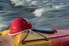 kayaking helmet on kayak deck