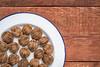 black walnuts a white plate