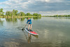 senior paddler on stand up paddleboard