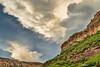 dramatic louds over cliff