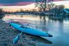 kayak and river at dusk