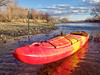 kayak and fence across river
