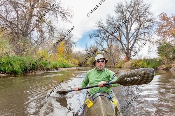 paddling sea kayak on a river