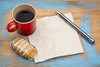 blank napkin with coffee and cookie
