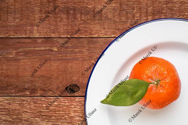 tangerine on metal enamel plate