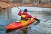 paddling river kayak on calm water