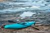kayak on river shore