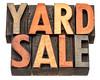 yard sale banner in wood type