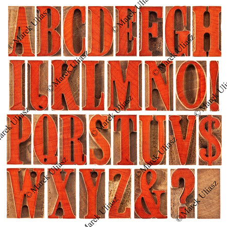 wood type alphabet stained by red
